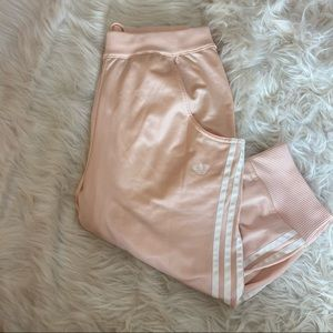 Adorable pink and white child's adidas joggers